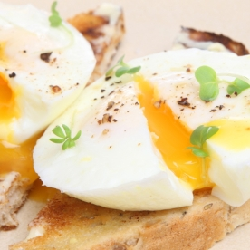 Perfectly poached fresh eggs on warm buttered toast.