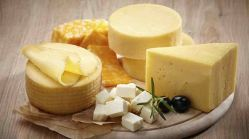cheeses on round board