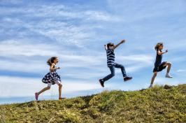 Kids running on hilltop