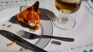 half-finished-glass-of-beer-and-pie-with-meat-on-plate-at-table_7yyj9nho__F0000.png